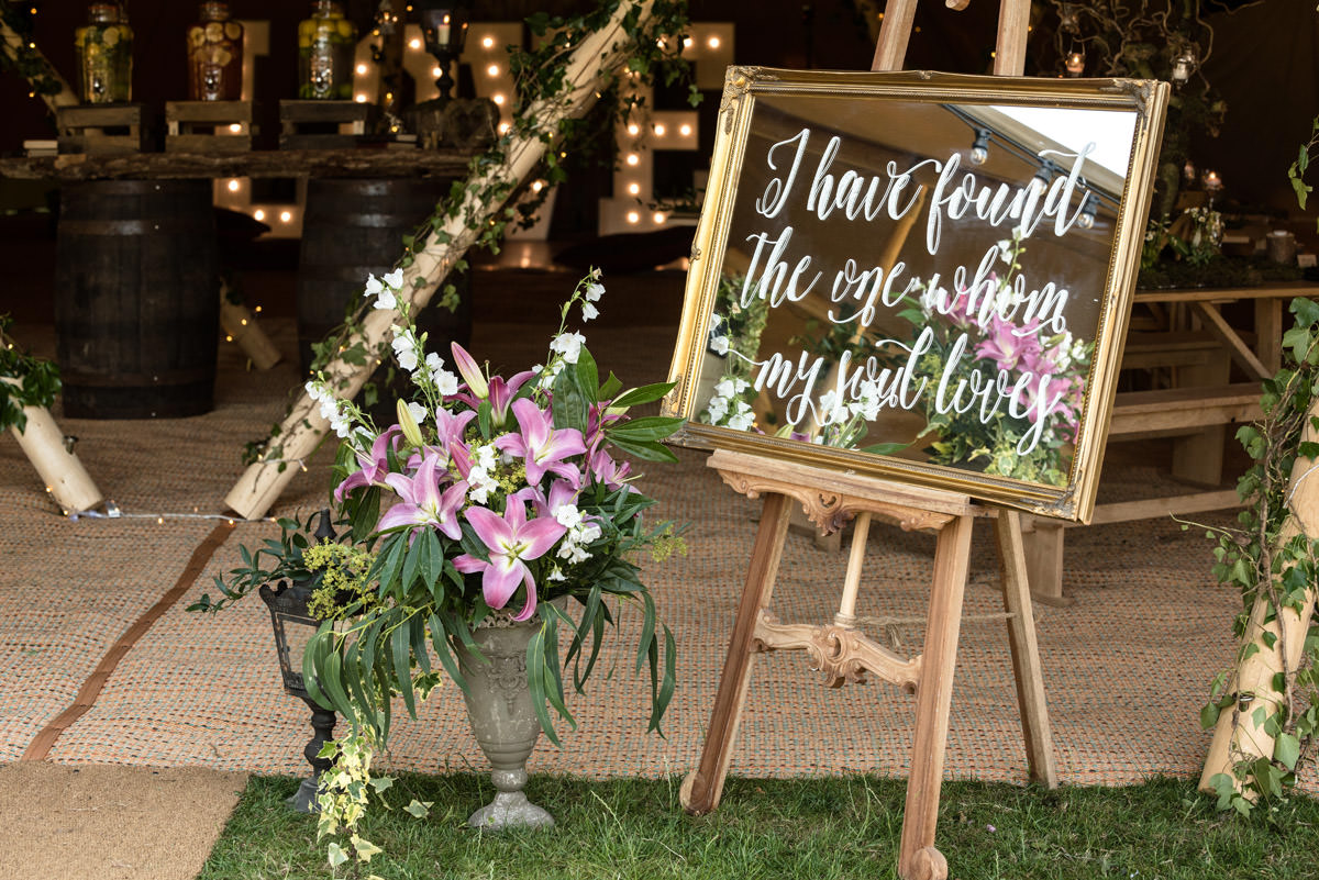 Mirrored wedding sign for a tipi wedding at Pipewell Hall
