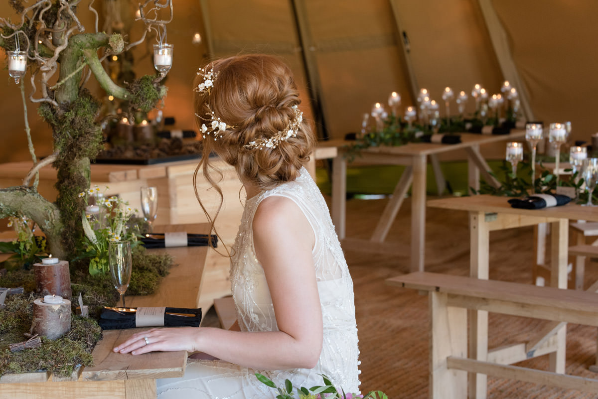 Back of the Bride's hair at a tipi wedding at Pipewell Hall