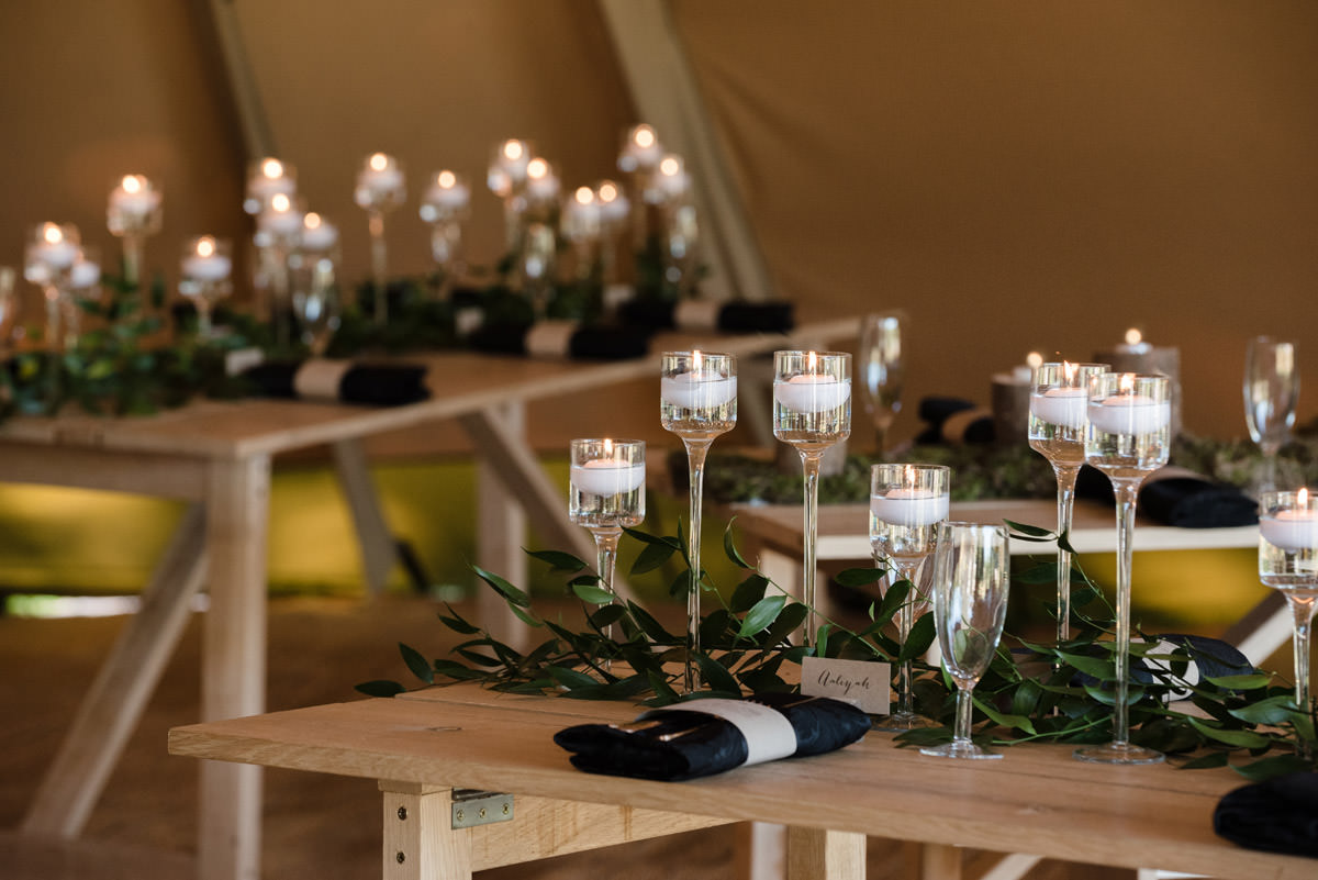Candlelit tables for a tipi wedding at Pipewell Hall