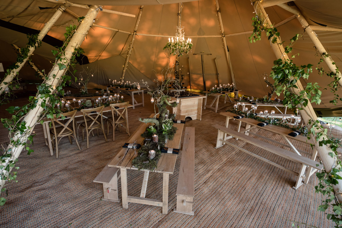 Table layout for a tipi wedding at Pipewell Hall