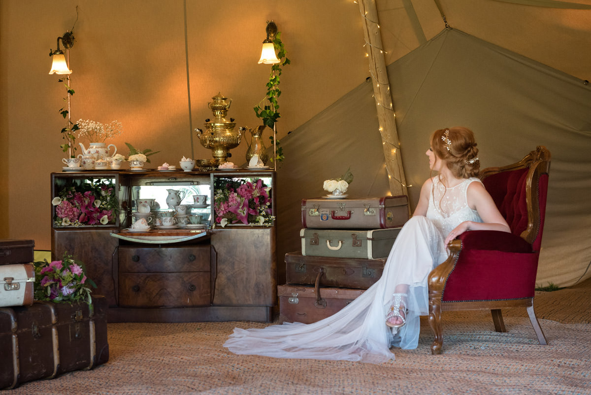 A vintage drinks cabinet at a tipi wedding at Pipewell Hall
