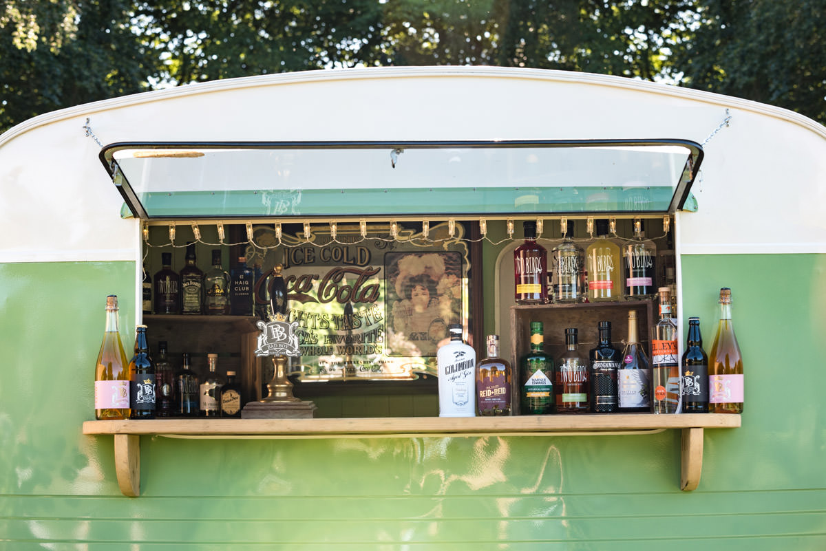 A vintage caravan serving drinks for a tipi wedding at Pipewell Hall