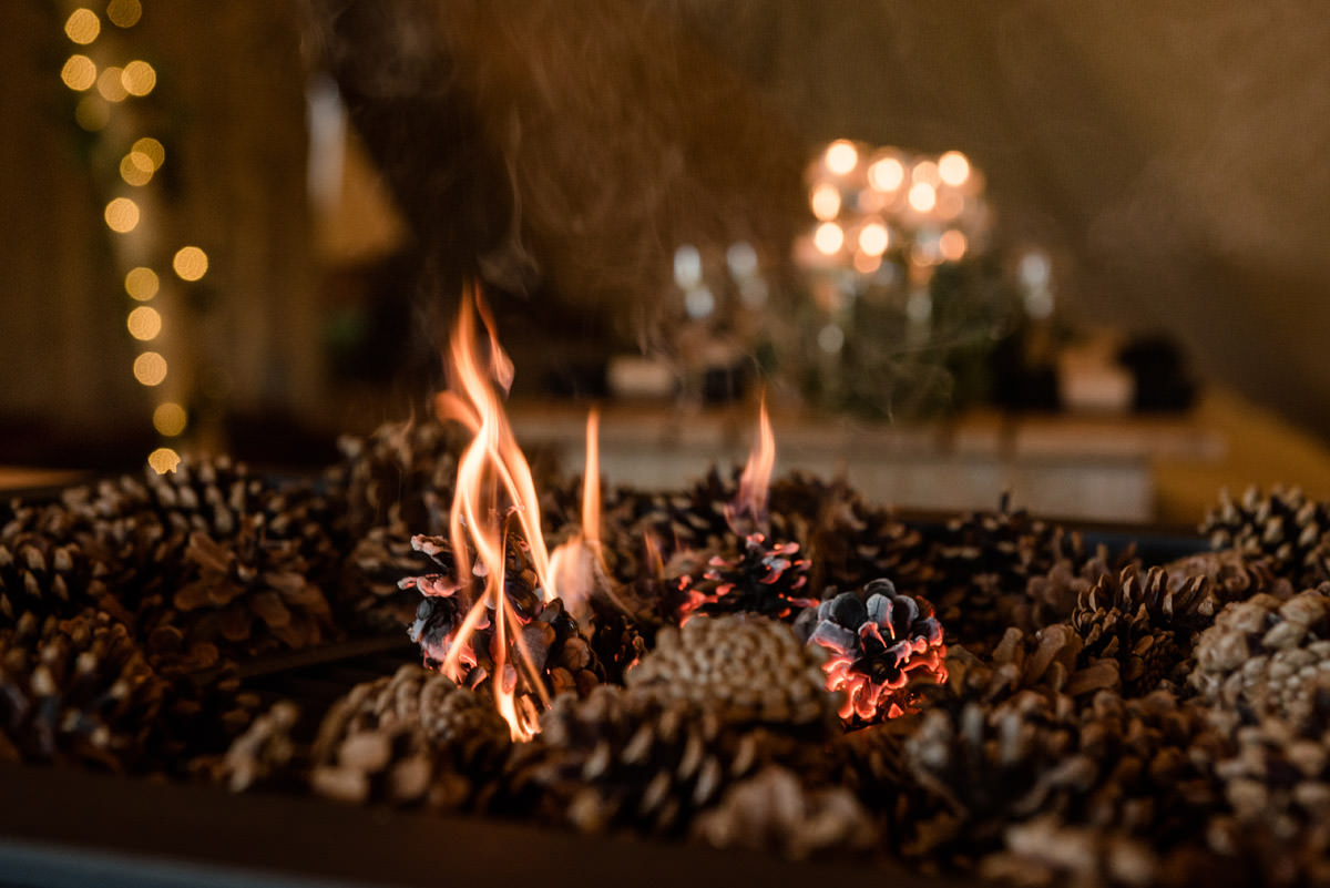 A fir cone fire pit for a tipi wedding at Pipewell Hall