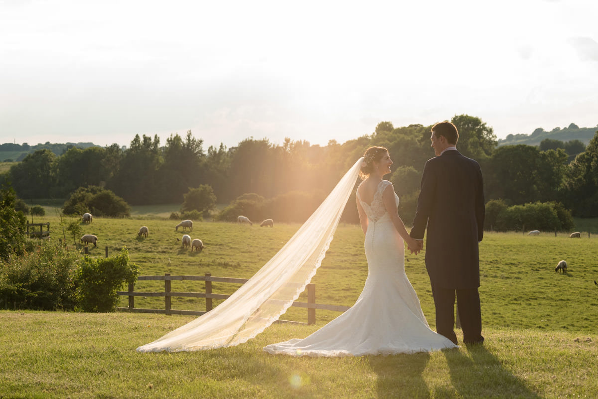 A Bride & Groom in the field at sunset at Dodford Manor