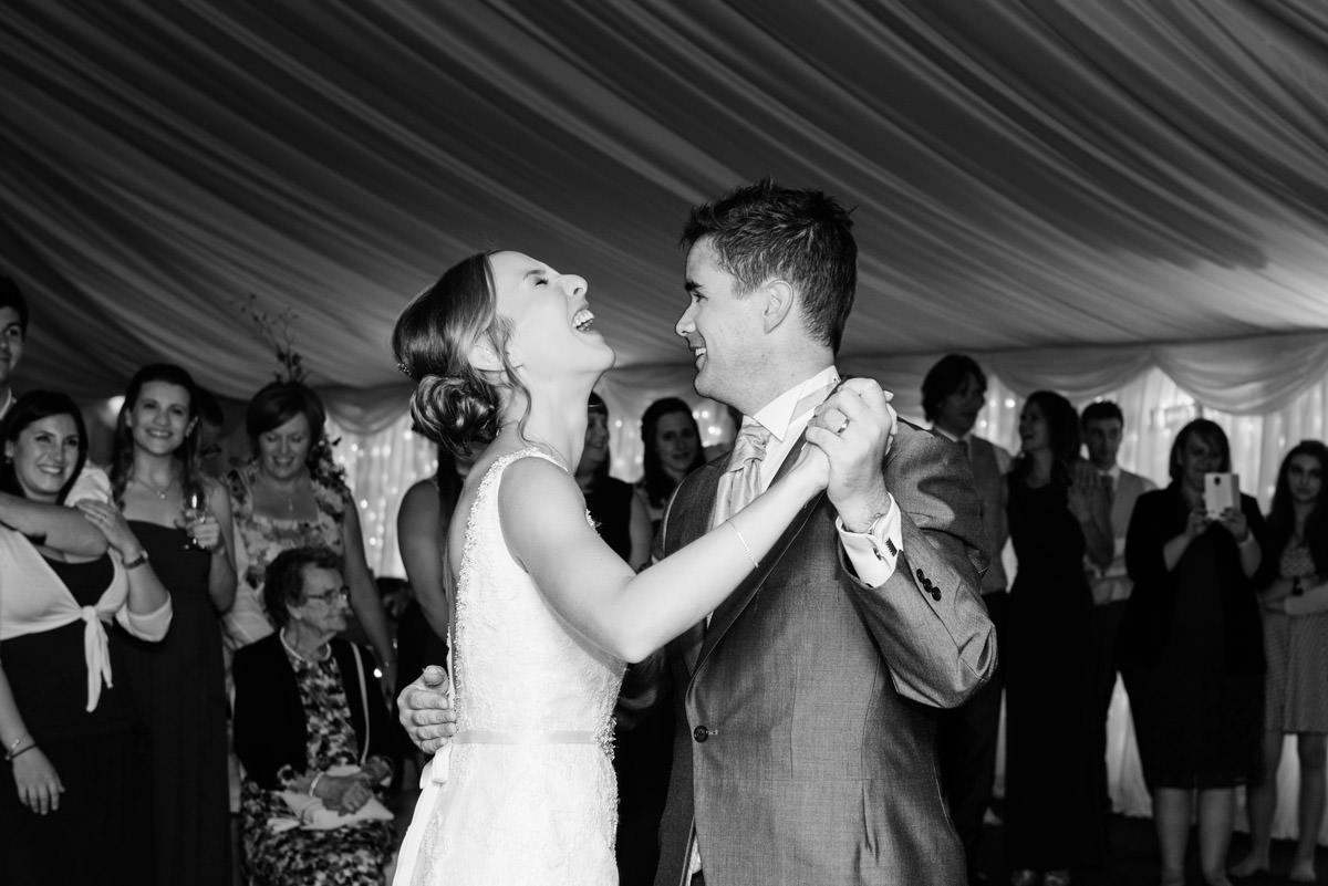 Bride & Groom laughing during their first dance