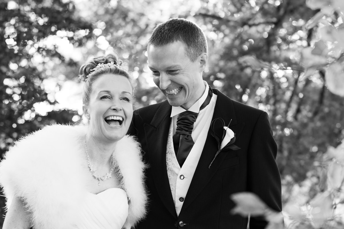 Bride & Groom laughing during their portraits at Rushton Hall in Northants