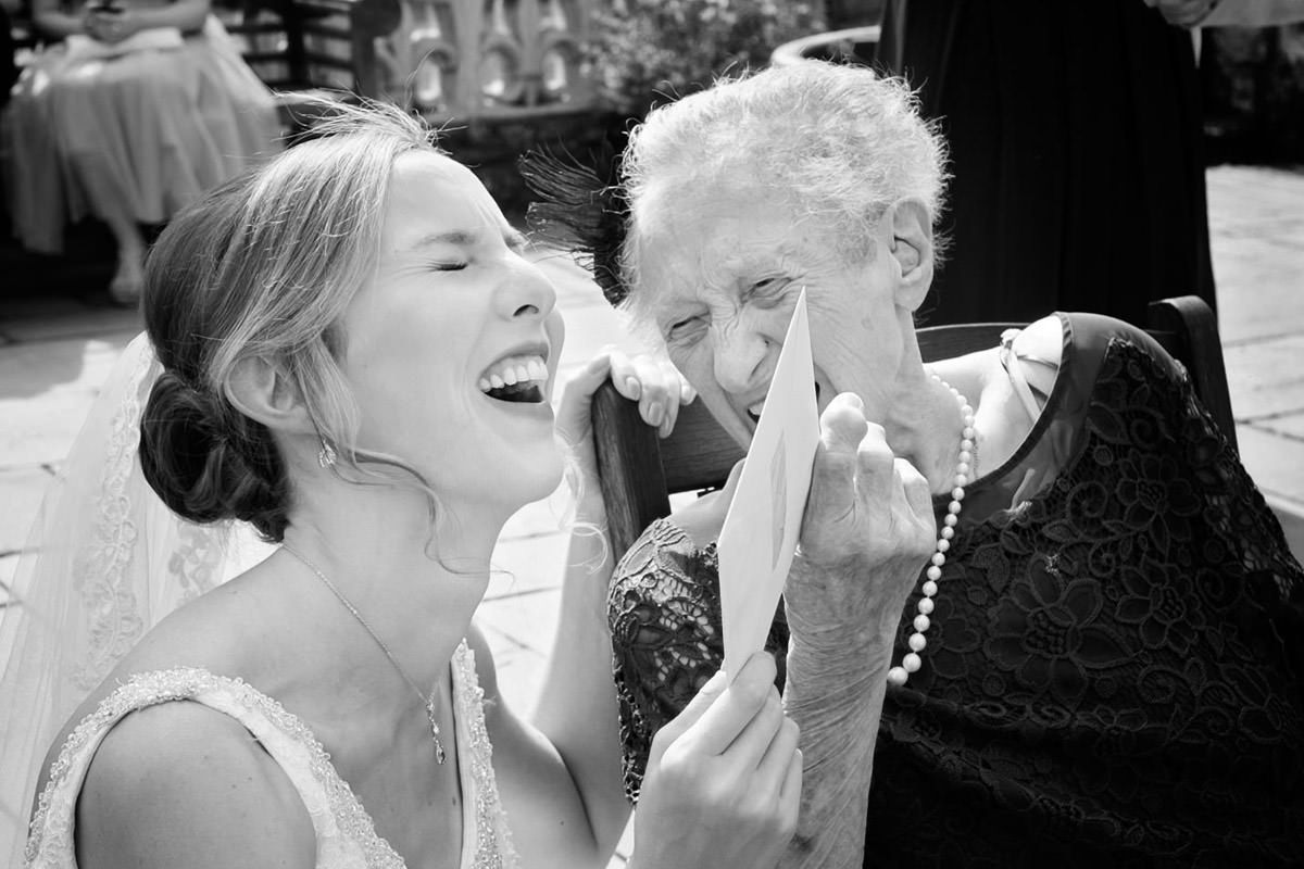 Bride laughing with her Grandmother during the wedding reception at Plum Park in Northants