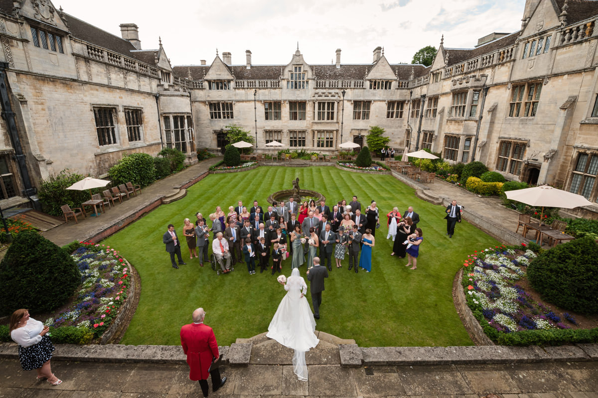 Drinks reception in the courtyard at Rushton Hall in Northamptonshire