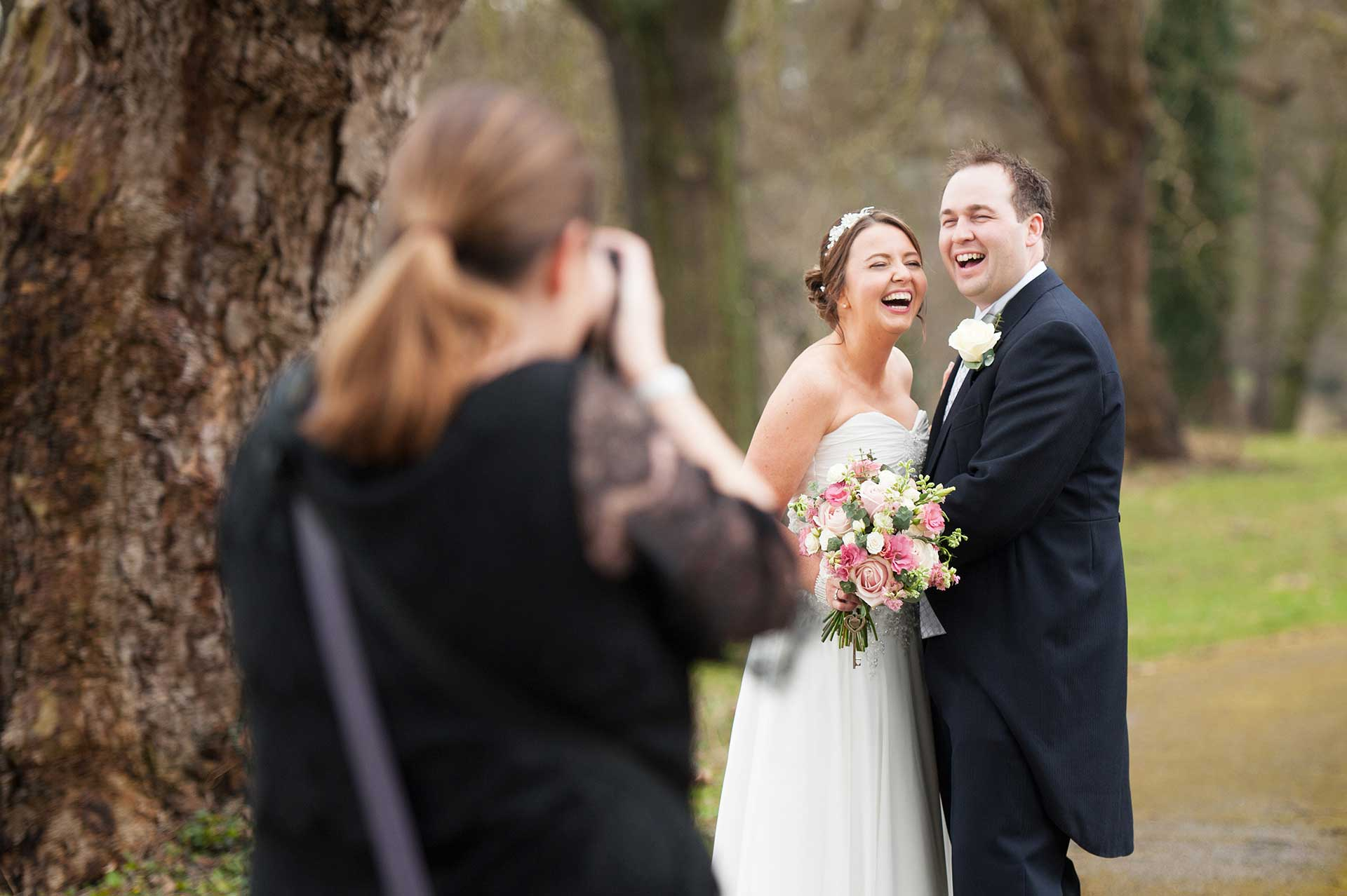 A couple laughing while having their photos taken by Sarah Vivienne