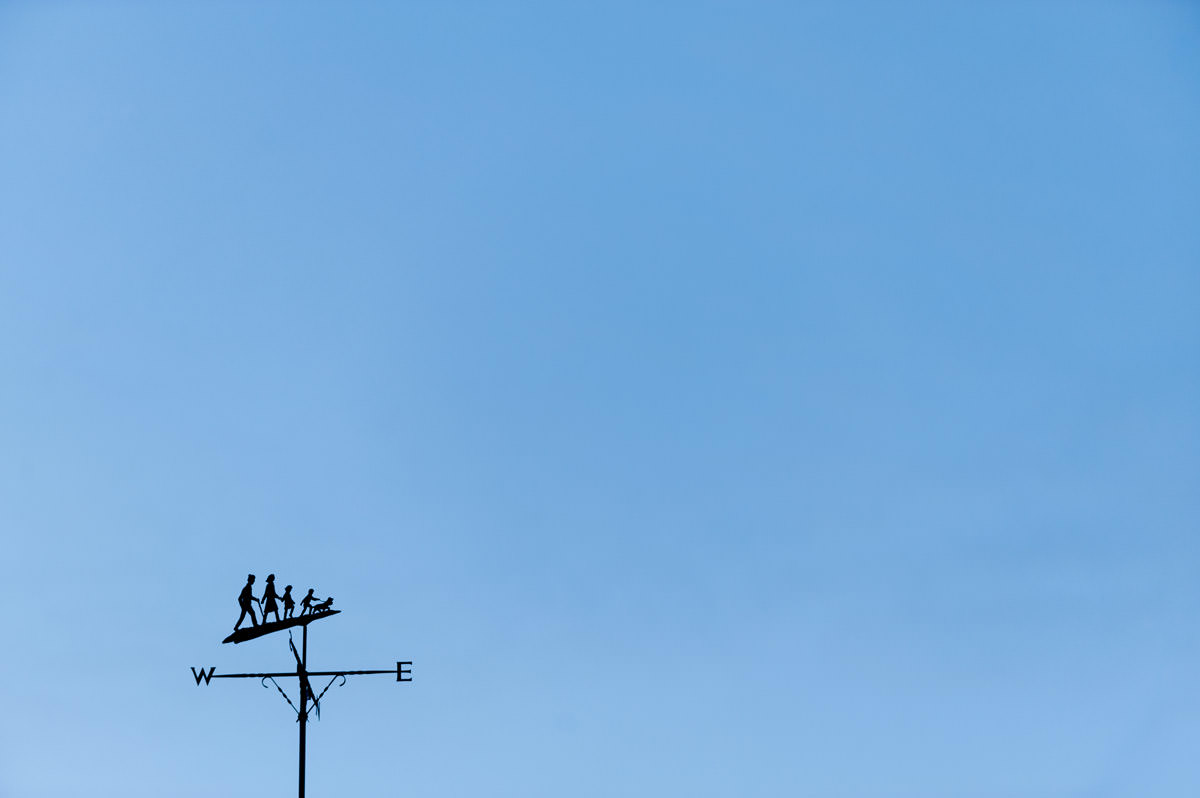 A weather vane against clear blue sky at Boughton House