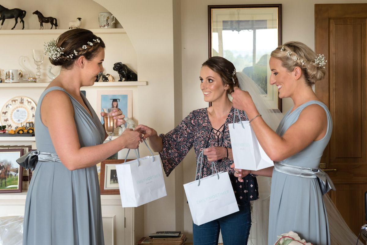 Bride handing out wedding gifts to her bridesmaids