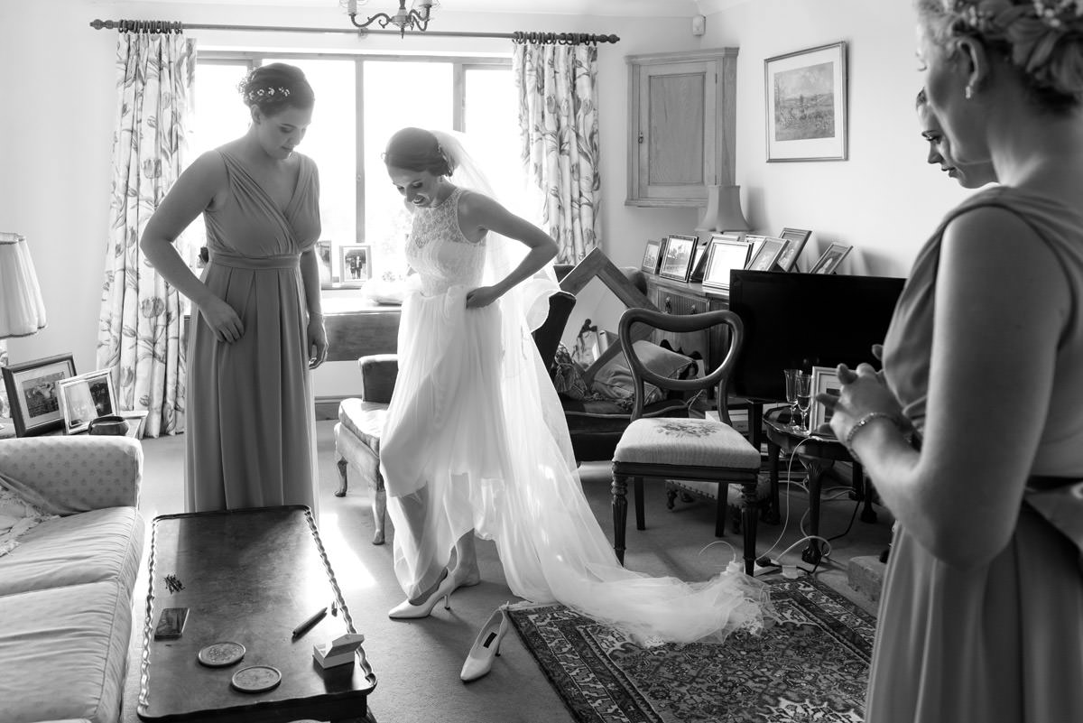 Bride putting on her wedding shoes