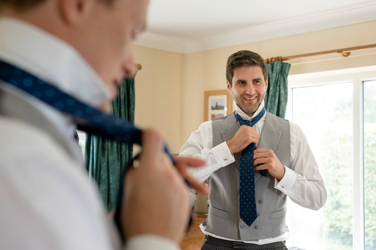 Ushers doing up their ties