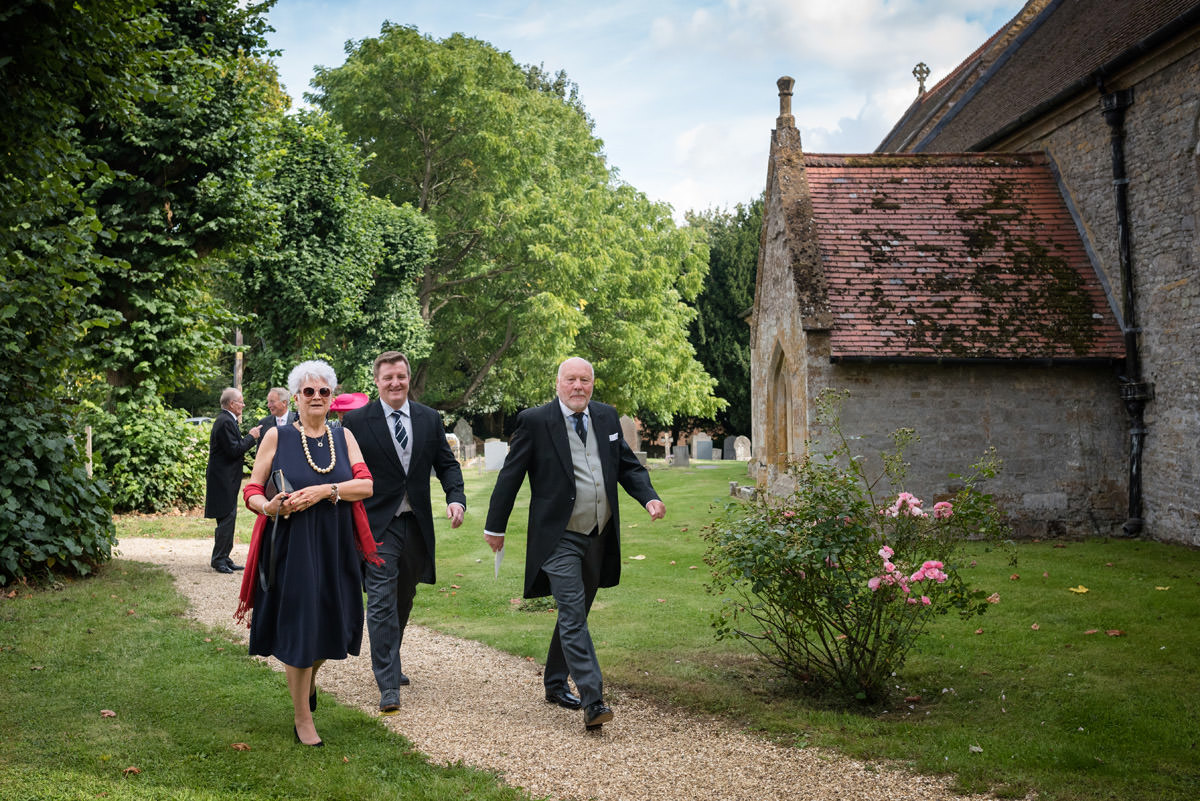 Guests arriving for a wedding at Maidwell church in Northampton