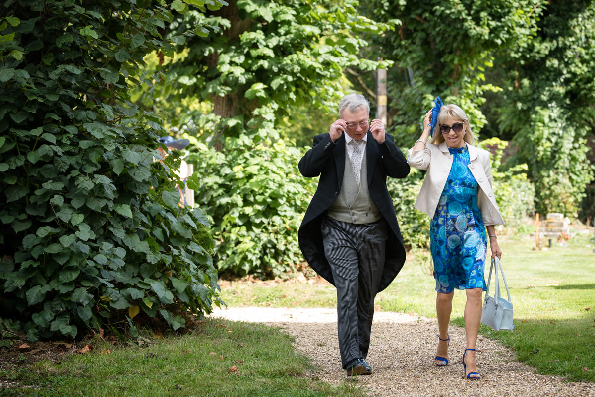 Wedding guests arriving at Maidwell church in Northampton