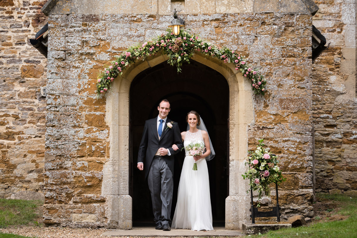 Bride & Groom coming out of Maidwell church in Northampton