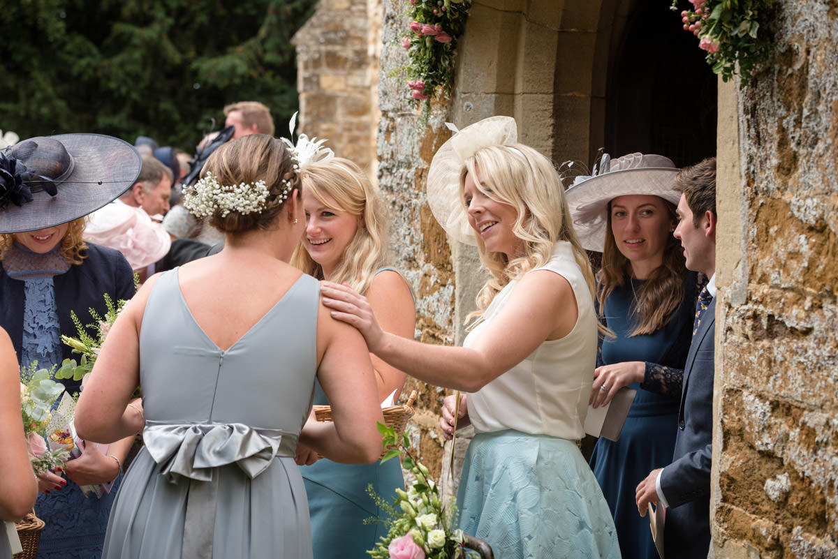 Wedding guests coming out of Maidwell church in Northampton
