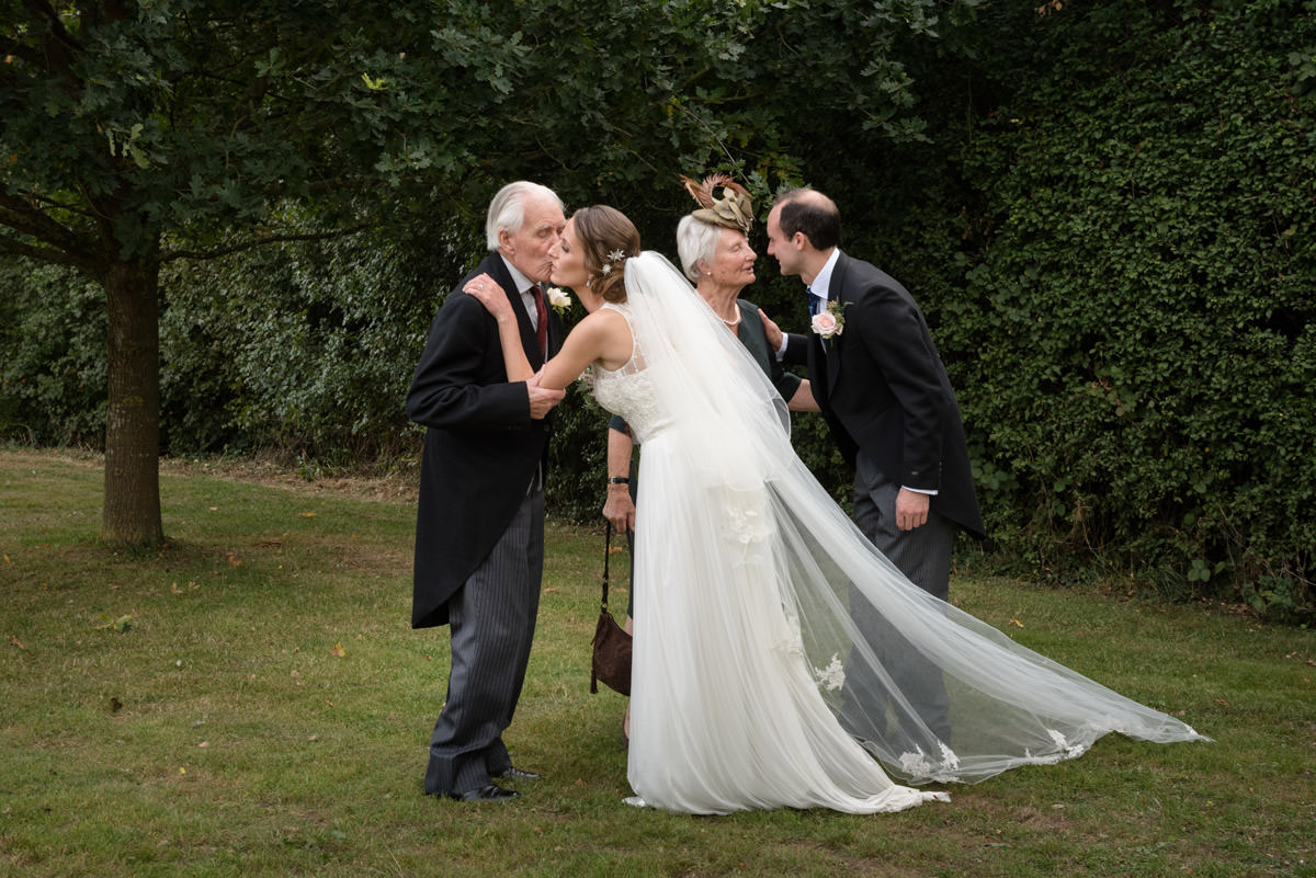 Bride and Groom greeting Grandparents at their wedding