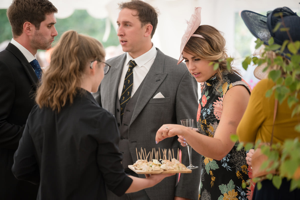 Canapes being served at a wedding drinks reception