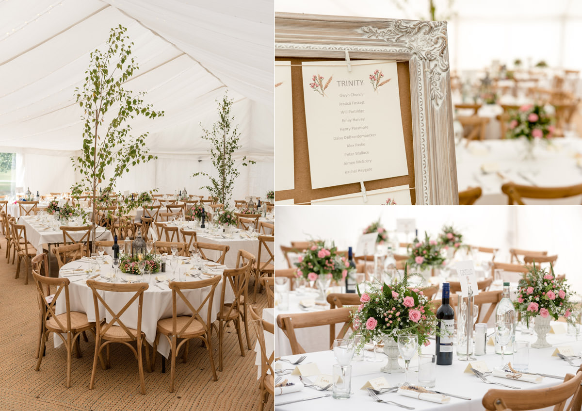 A wedding marquee with trees and rustic decor