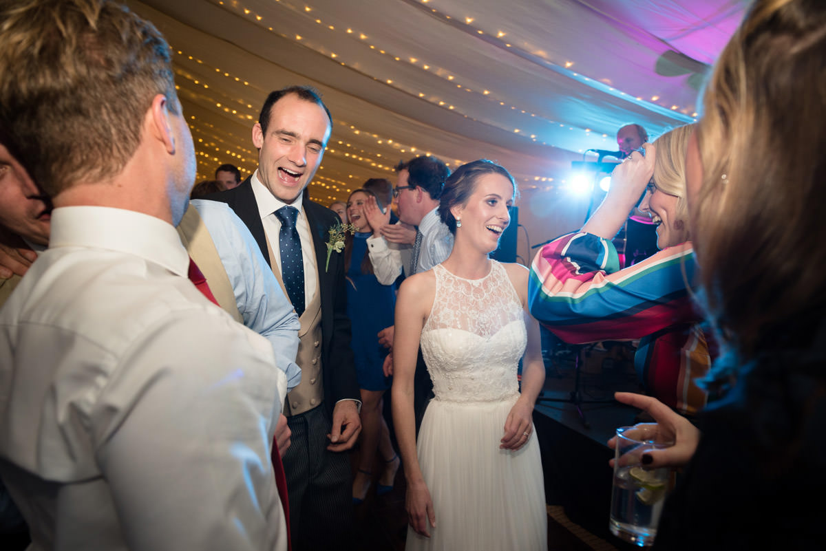 Bride & Groom dancing with their guests