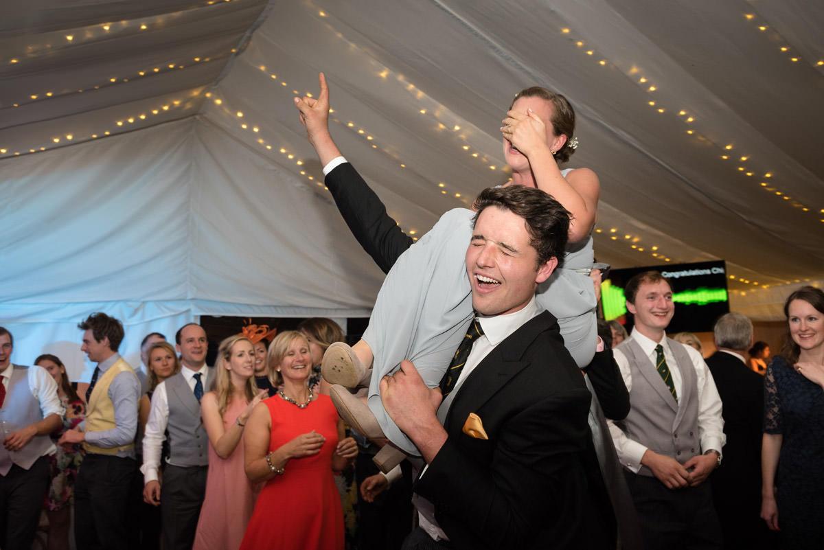 Bridesmaid on Usher's shoulders on the dance-floor