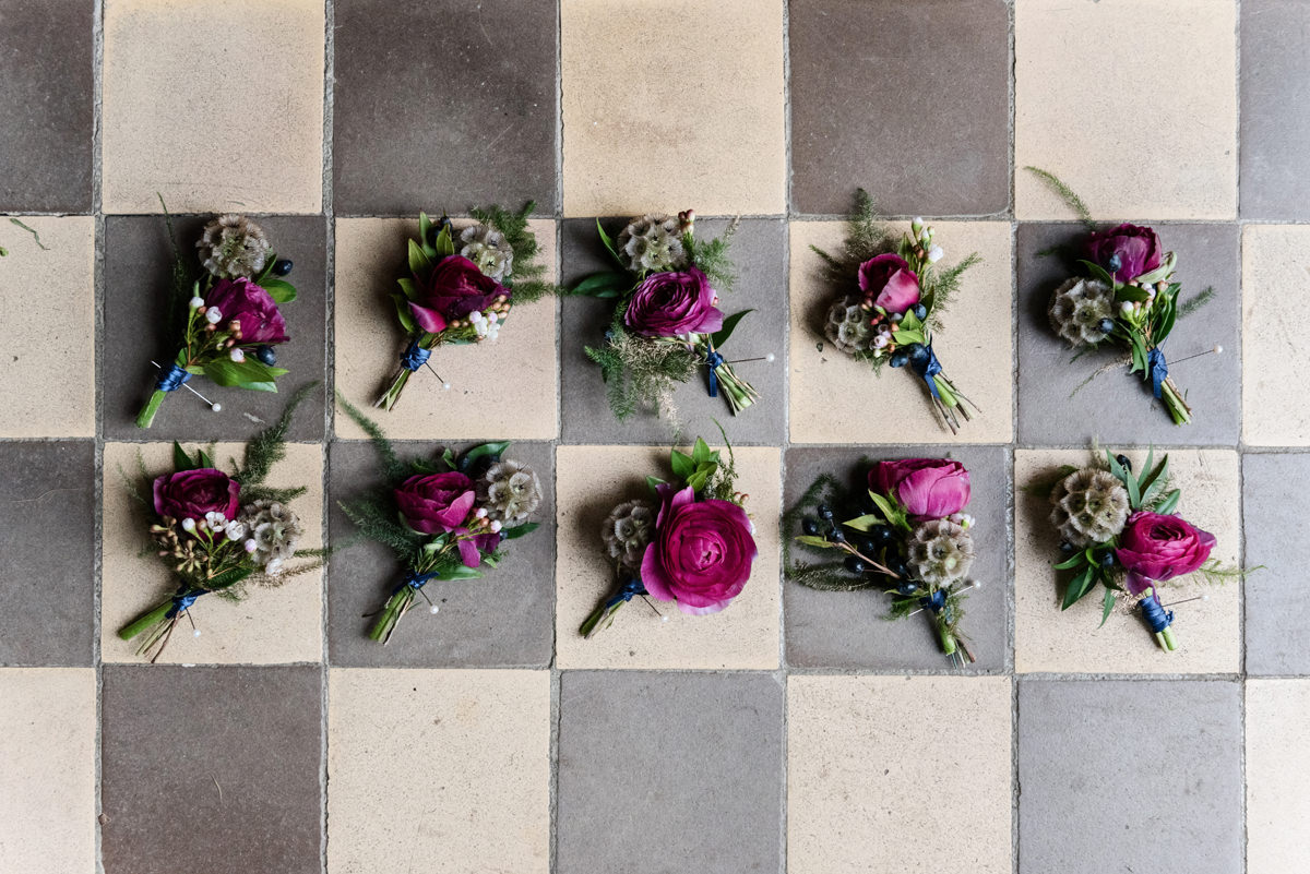 Wedding buttonholes on a chequerboard tiled floor