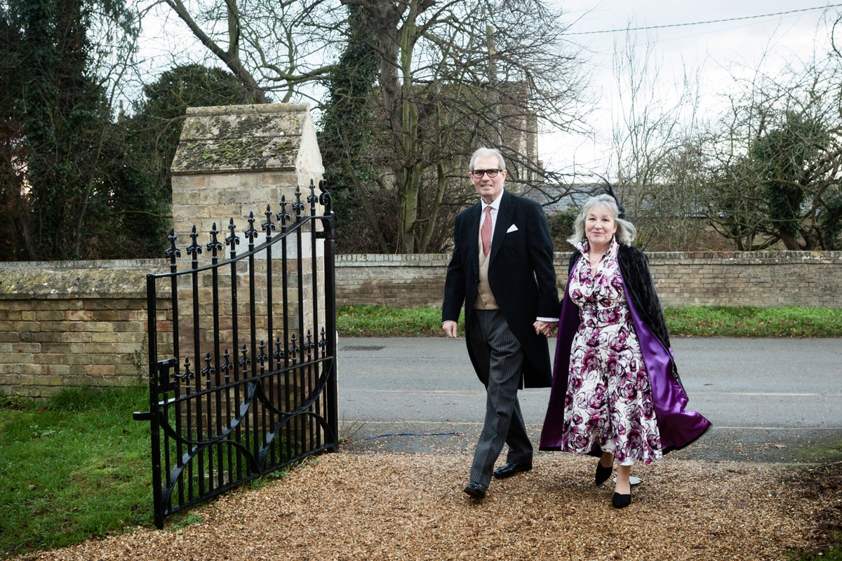 Wedding guests arriving at St Andrew's church in Swavesey, Cambridge