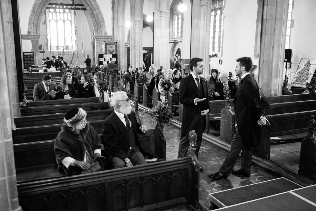 Guests waiting inside St Andrew's church in Swavesey, Cambridge