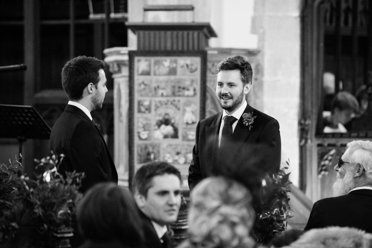 Groom waiting with his best man at St Andrew's church in Swavesey, Cambridge