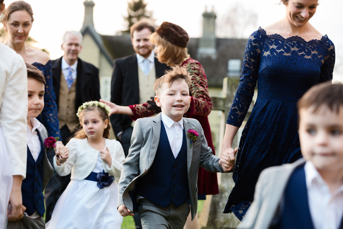Bridal party arriving at St Andrew's church in Swavesey, Cambridge