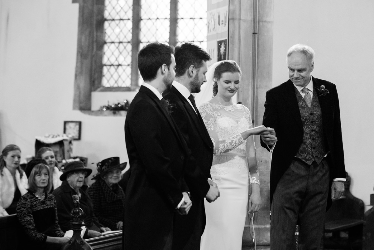 Father of the bride giving his daughter away at St Andrew's church in Swavesey