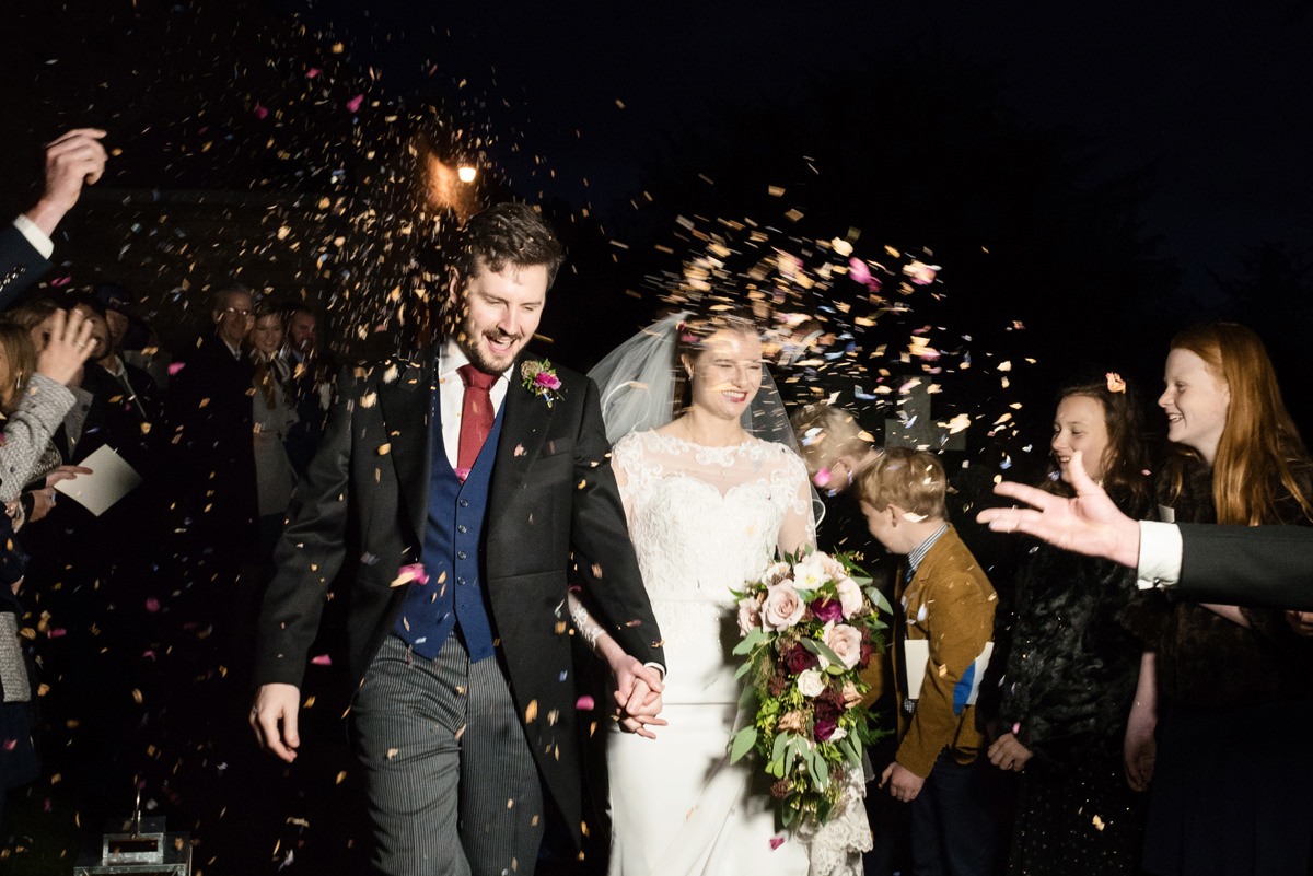 Confetti in the dark at St Andrew's church in Swavesey, Cambridge