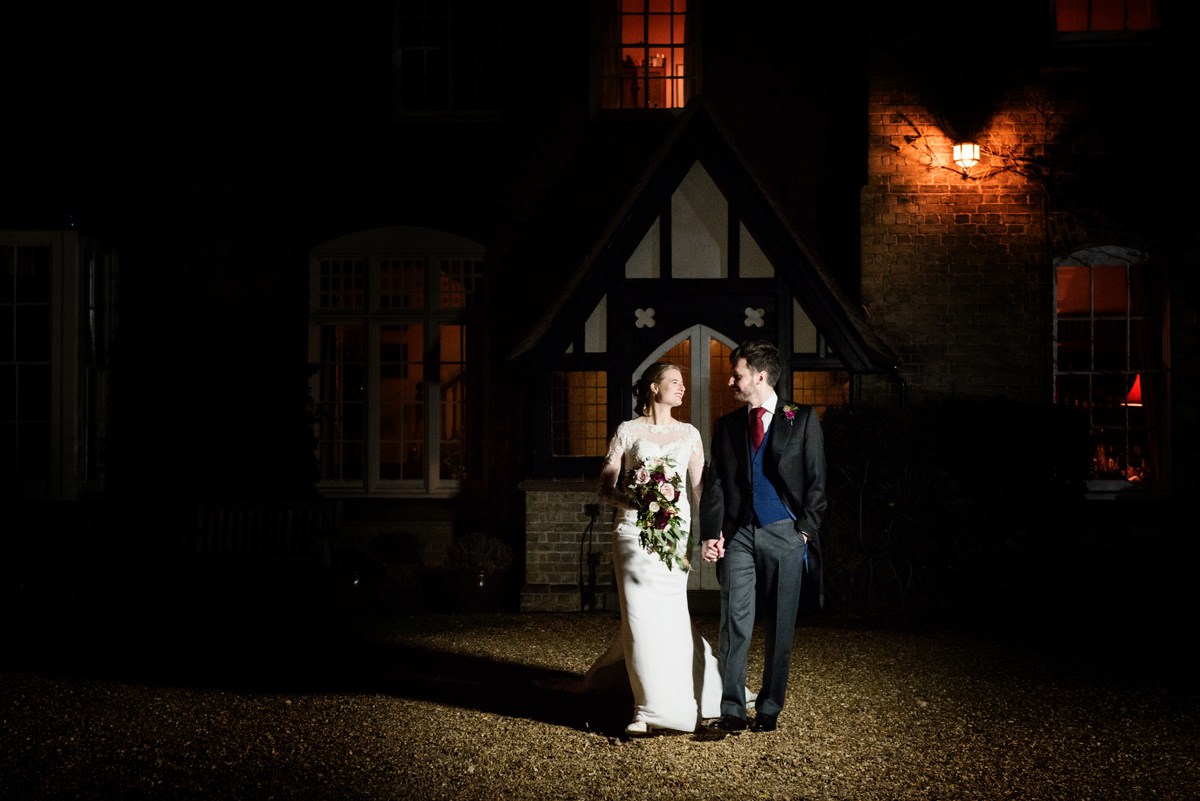 The bride and groom walking at home in Swavesey, Cambridge