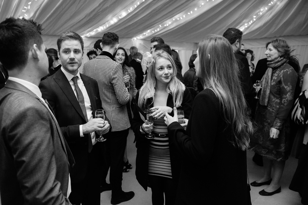 A wedding drinks reception in a marquee in Swavesey, Cambridge