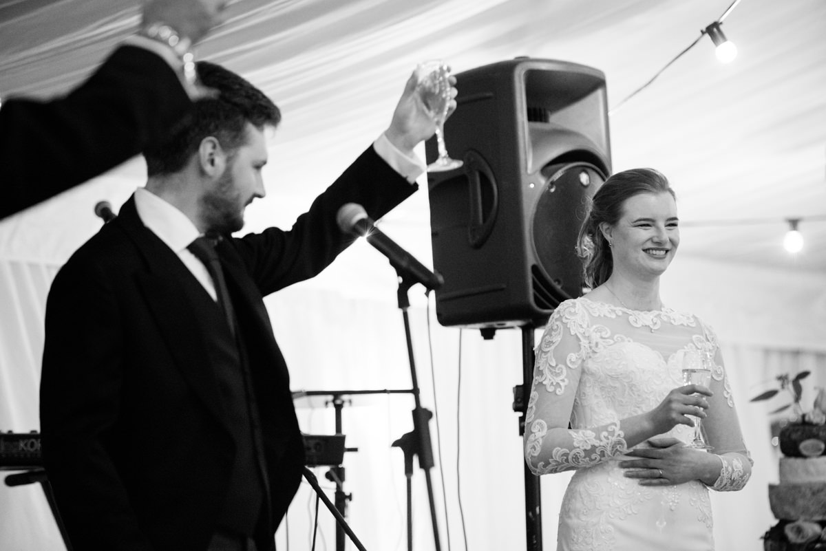 The groom toasting the bride in Swavesey, Cambridge