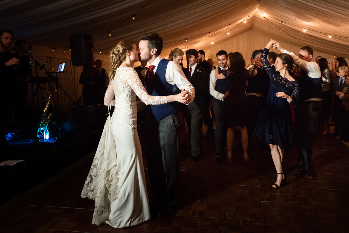 Bride and groom kissing on the dancefloor at their wedding in Swavesey, Cambridge