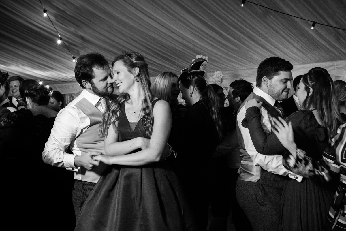 Wedding guests dancing at a marquee wedding in Swavesey, Cambridge