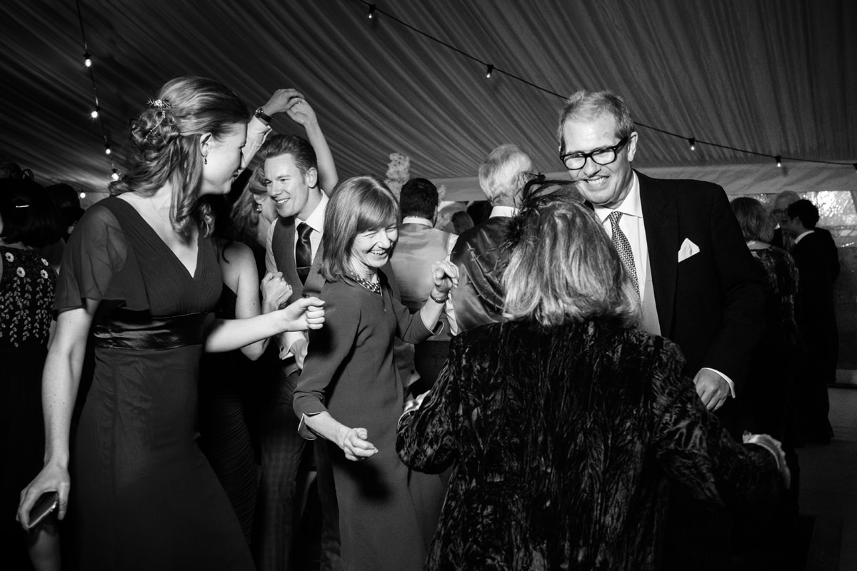 The bride's family dancing at a marquee wedding in Swavesey, Cambridge