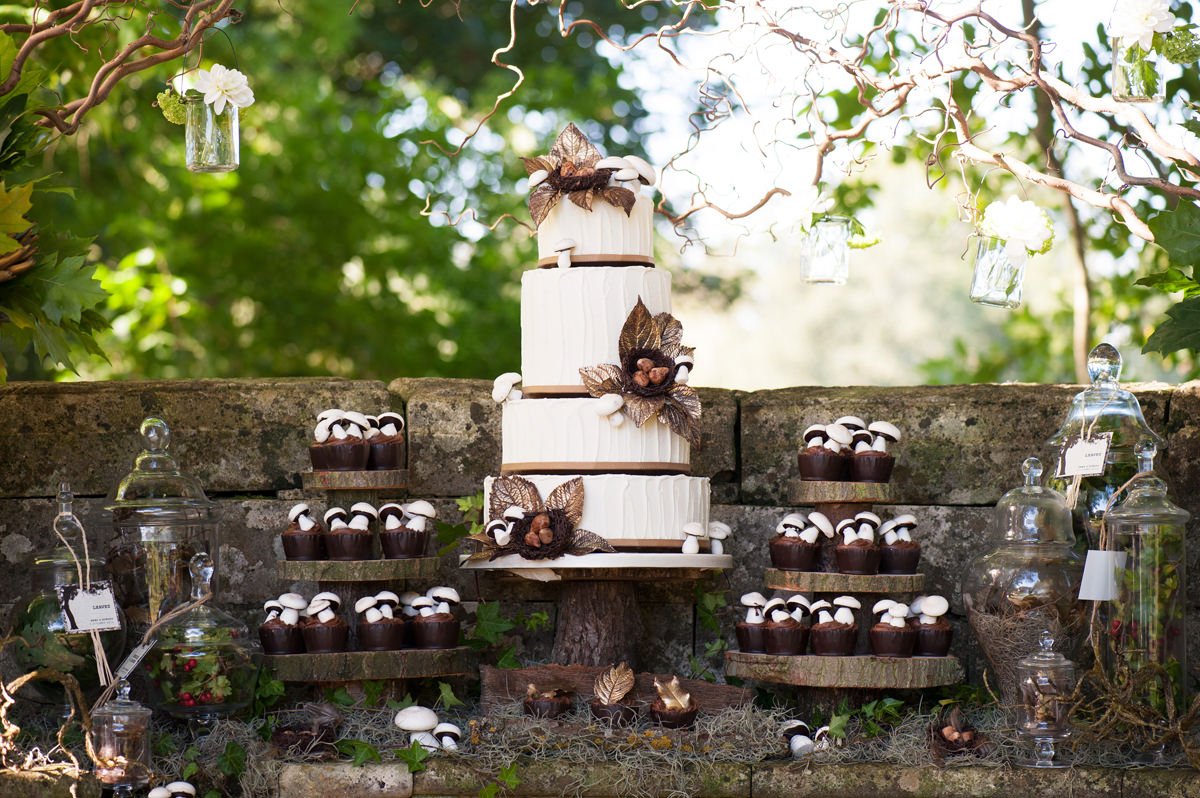 An outdoor woodland themed wedding cake dessert table by Couture Cakes