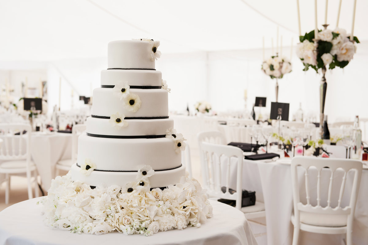 An elegant Chanel themed wedding cake for a black and white wedding at Pipewell Hall