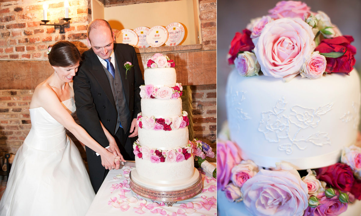A white wedding cake with iced embossing and fresh flowers by Couture Cakes