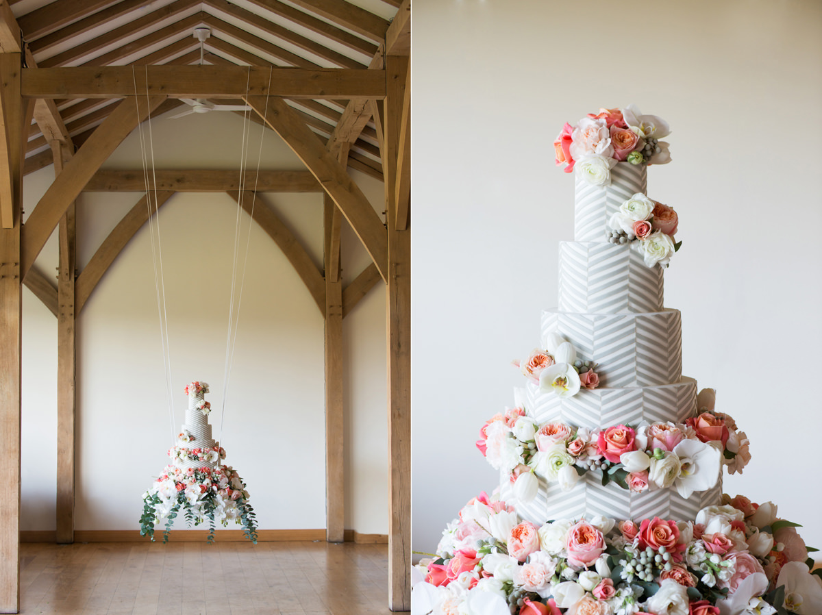 A hanging wedding cake suspended from a barn beam at Dodford Manor in Northampton