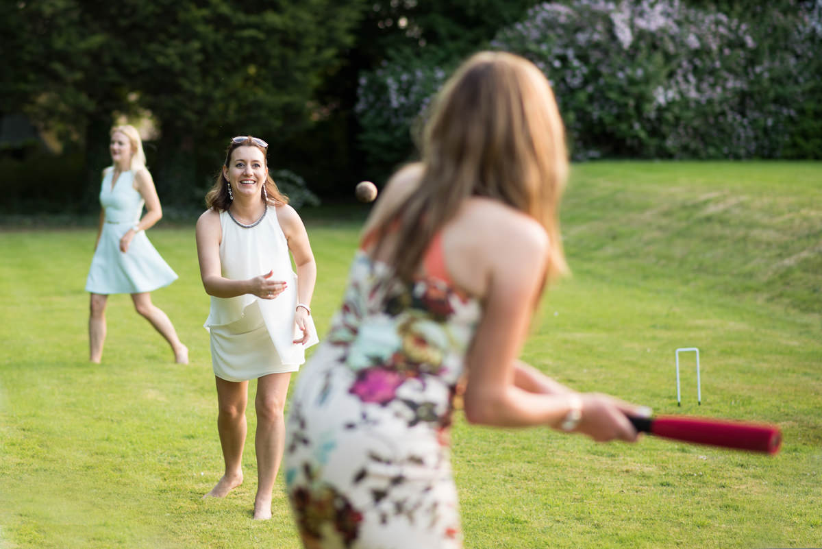 Wedding guests playing rounders