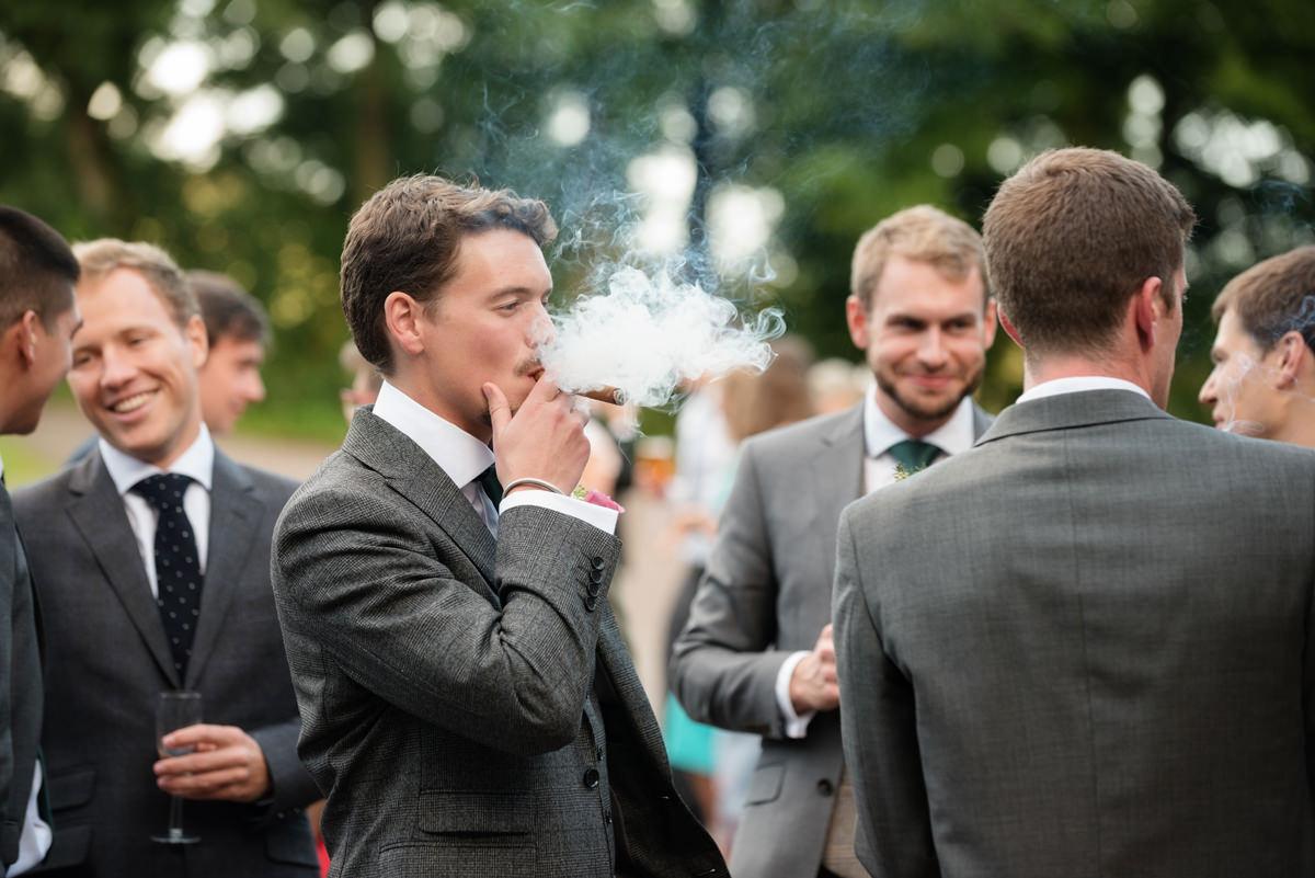 Smoking a cigar at a wedding