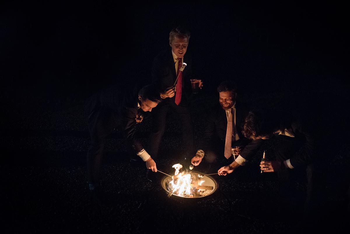 Toasting marshmallows at a wedding
