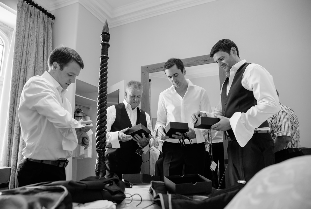 Groomsmen opening wedding gifts at Notley Abbey