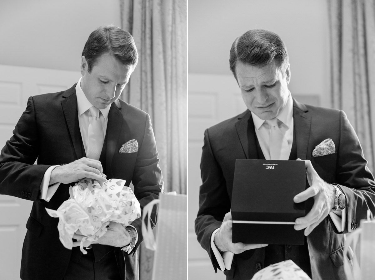 Groom opening wedding gift from bride at Notley Abbey