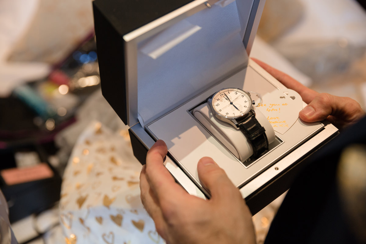 Close up photo of groom's wedding gift (a watch) from the bride