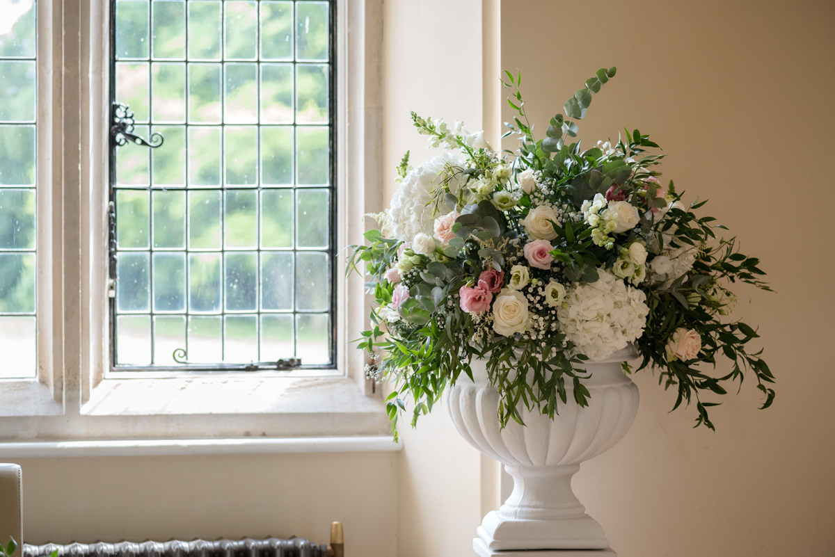 Flower pedestal in the ceremony room at Notley Abbey